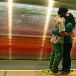 Couple kissing at Chile's subway