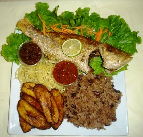 Waakye with fried red snapper and plantain, served with a rich tomato gravy
