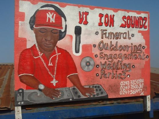 Wall graffiti advertisement of DJ for weddings and funerals
