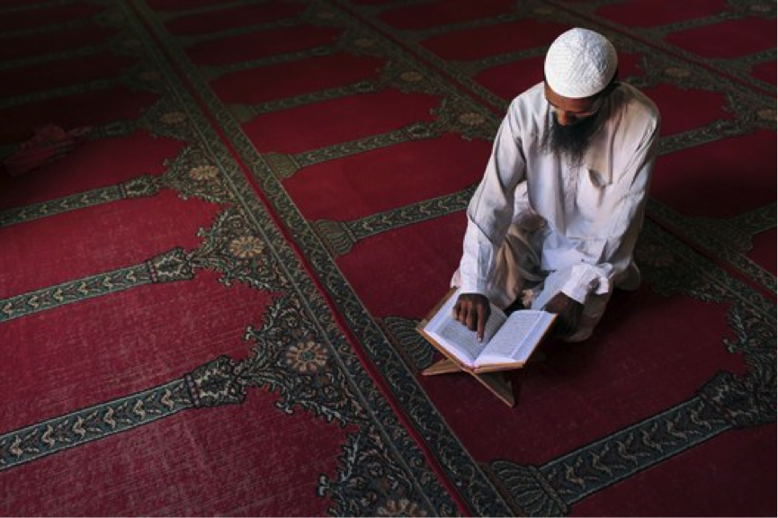 Bangladeshi reading Quran