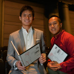 Zi Liang and Zak with the book on the day of the book launch in August