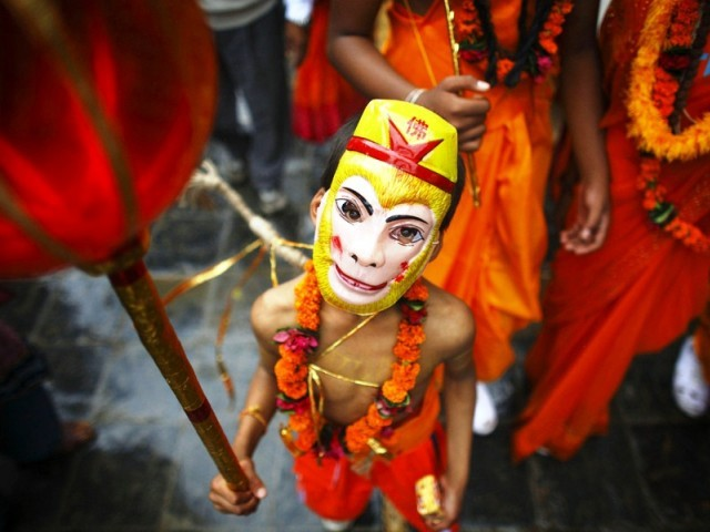 A boy is dressed up for Gai Jatra