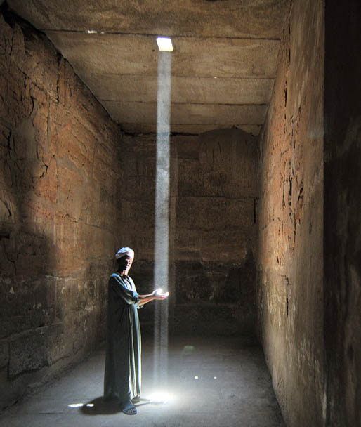 A man stands inside the Karnak Temple in Luxor, Egypt