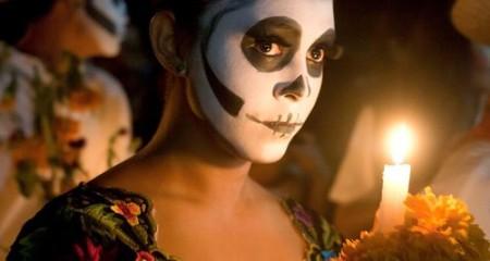 A lady participates in Dia de los Muertos dressed as Catrina
