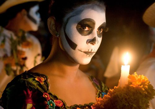 A lady participates in Dia de los Muertos dressed as Catrina