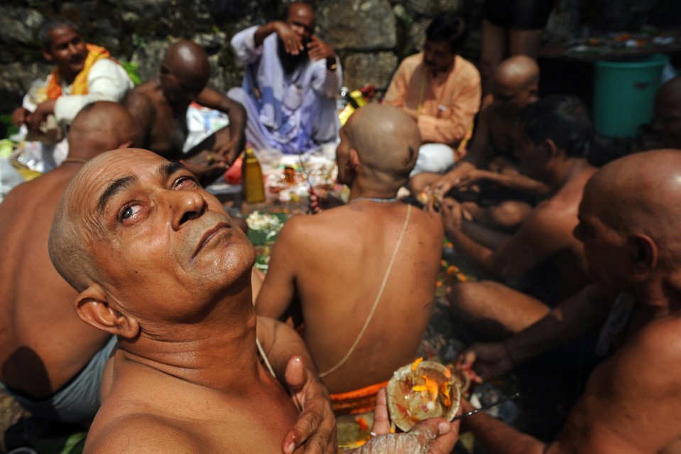 Men participate in the Pitru Paksha ritual