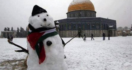 A snowman in front of Dome of the Rock, Jerusalem, Israel.