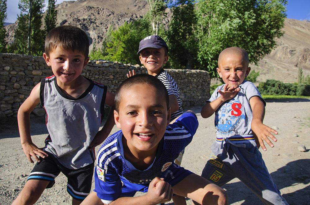 Enthusiastic boys wanting their photos taken