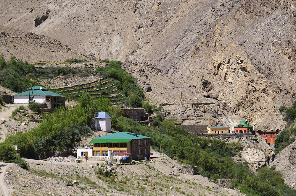 The Bibi Fatima hot springs are the vermilion-coloured buildings (right)