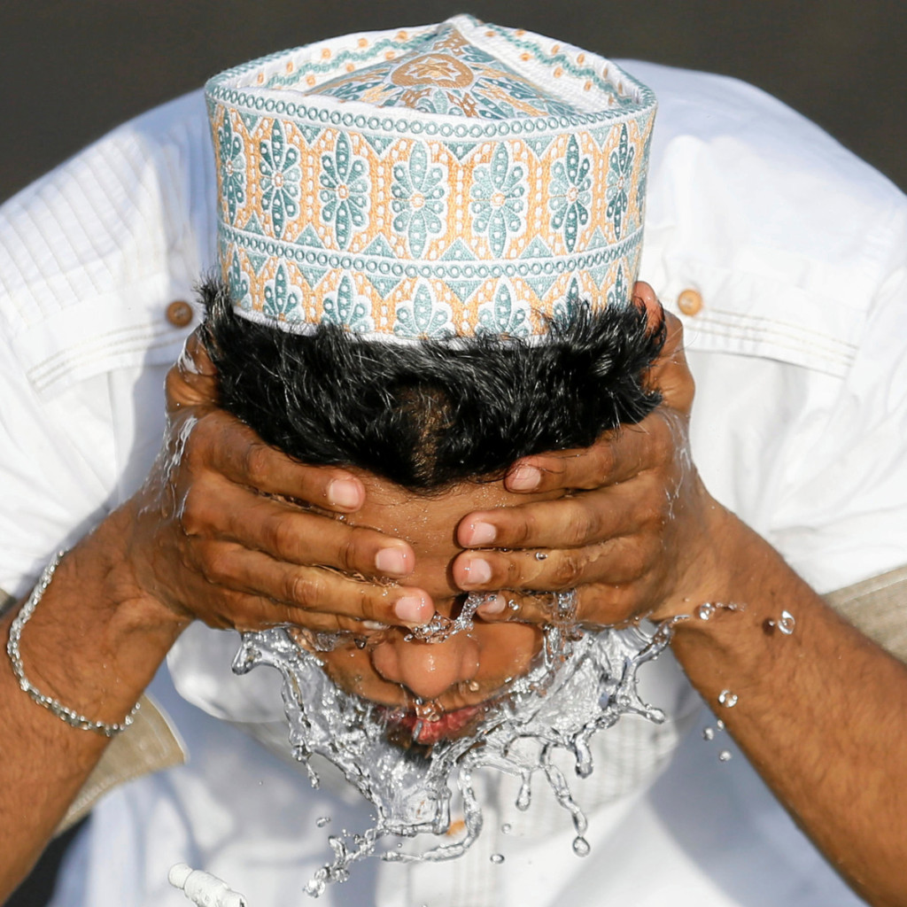 A man performs ablution before Eid prayers in Colombo, Sri Lanka [Dinuka Liyanawatte/Reuters]